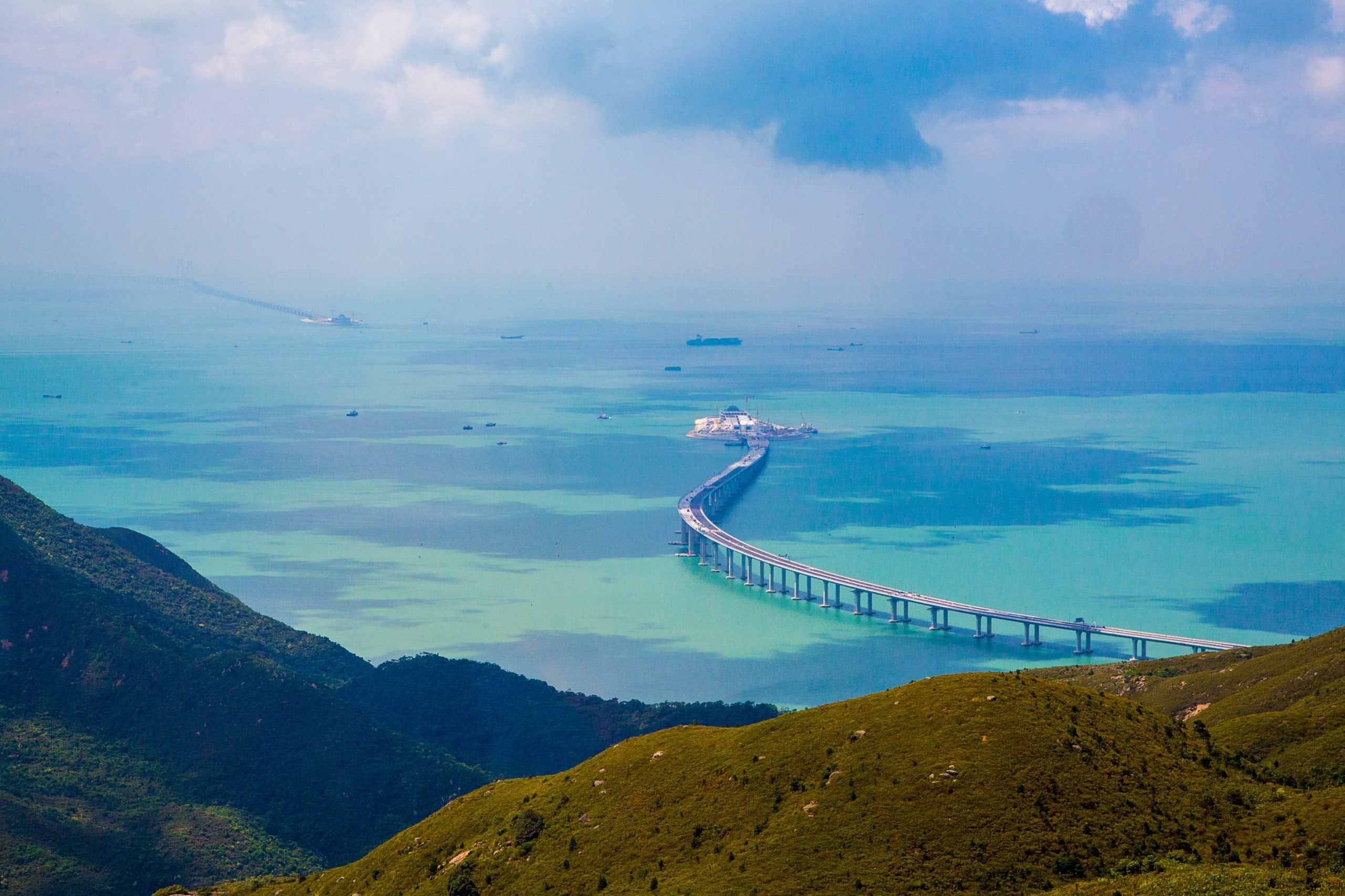 Aerial view of the Lantau Island in Hong Kong with nature, new bridge and the ocean